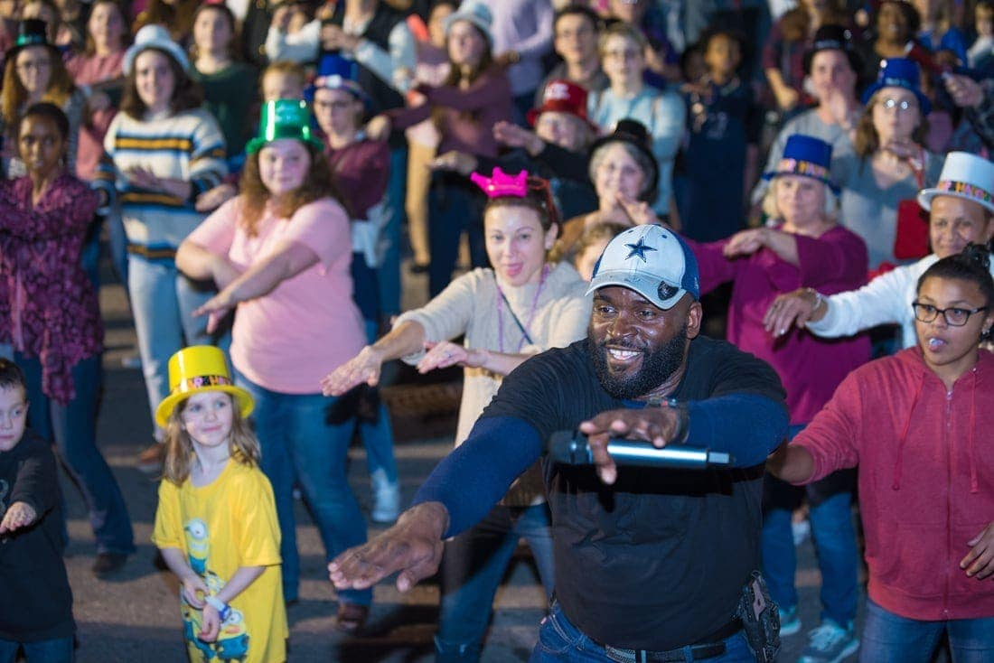 DJ (and Mt. Olive employee) L.J. Manley leads the New Year's Eve crowd in line dancing.